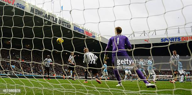 Newcastle player Yoan Gouffran deflects a shot by Cheick Tiote into the City goal past Joe Hart but the 'goal' is dissalowed during the Barclays...