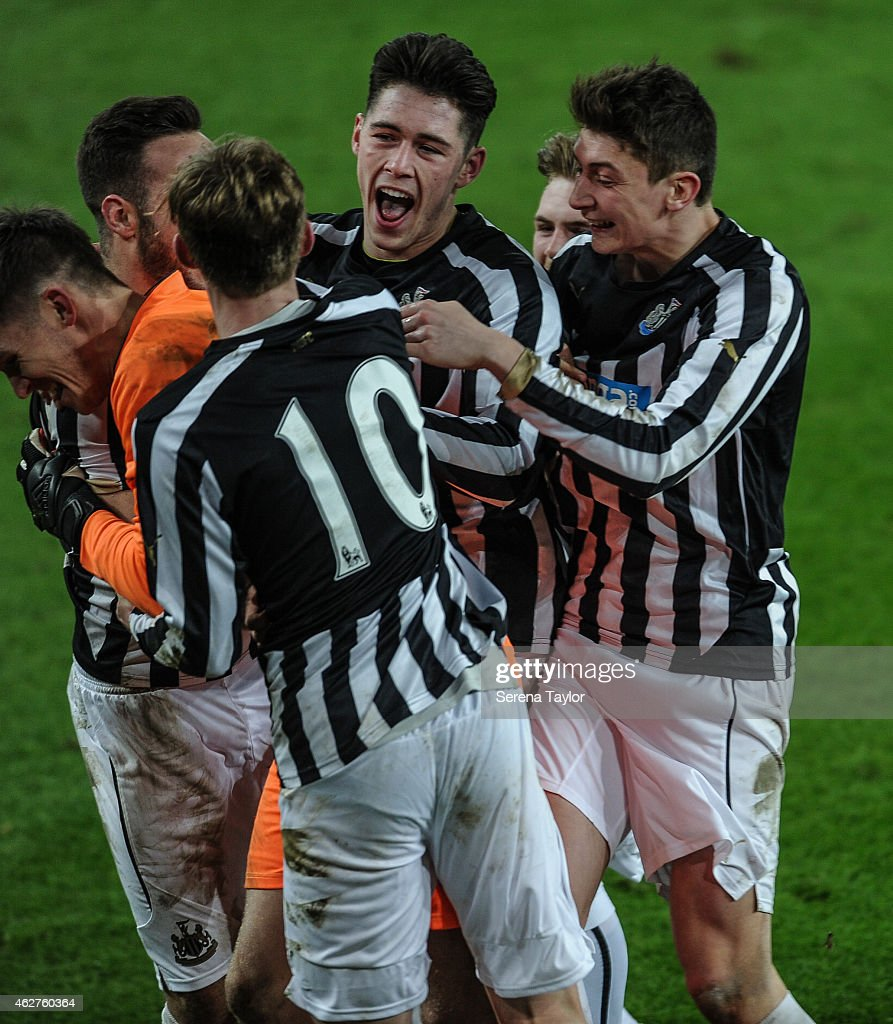 Newcastle players (seen L-R) Adam Armstrong (Partially hidden), Sean Longstaff, Ben Pollock, Mackenzie Heaney (Partially Hidden) and Jamie Cobain celebrate with Newcastle Goal Keeper Freddie Woodman (Orange) after winning the FA Youth Cup Round 5 match between Sunderland AFC and Newcastle United at The Stadium of Light on February 04, 2015, in Sunderland, England.