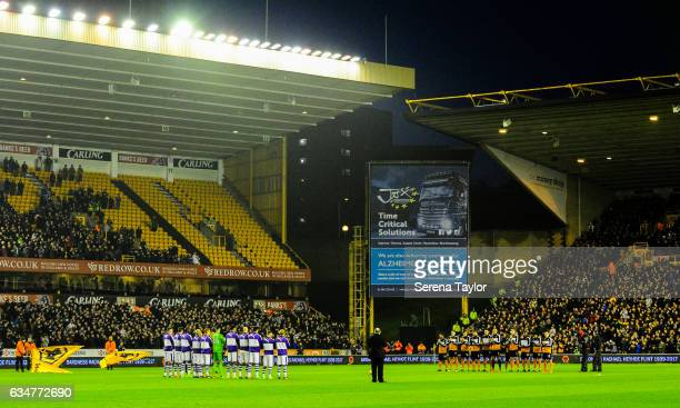 Newcastle Players and Wolverhampton Players line up for a minutes applause prior to kick off of the Sky Bet Championship match between Wolverhampton...