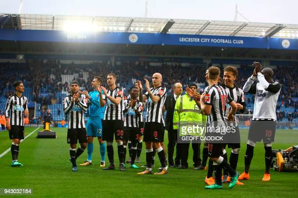 Newcastle players applaud at the end of the English Premier League football match between Leicester City and Newcastle United at the King Power...