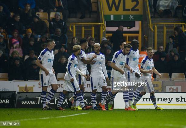 Newcastle players celebrate after Aleksandar Mitrovic of Newcastle United scored the opening goal during the Sky Bet Championship match between...