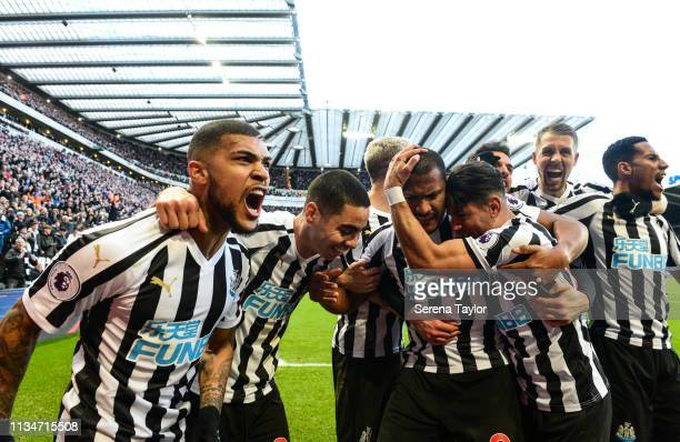Newcastle players celebrate after Ayoze Perez Idrissa Gueye of Everton scores Newcastle's third goal during the Premier League match between...