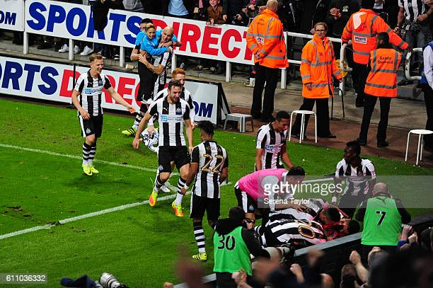 Newcastle players celebrate after Dwight Gayle scored the fourth and winning goal in injury time during the Sky Bet Championship match between...