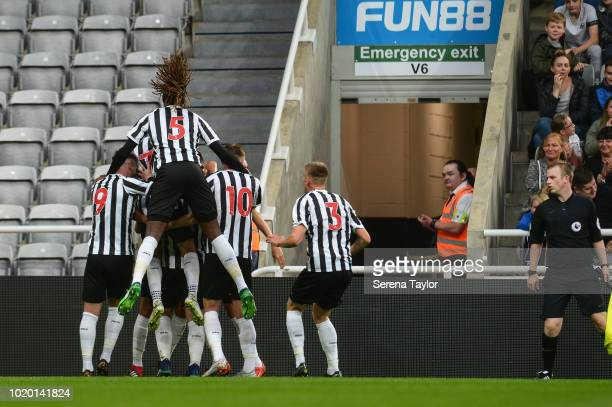 Newcastle players celebrate after Owen Bailey scores the opening goal for Newcastle during the Premier League 2 Match between Newcastle United and...
