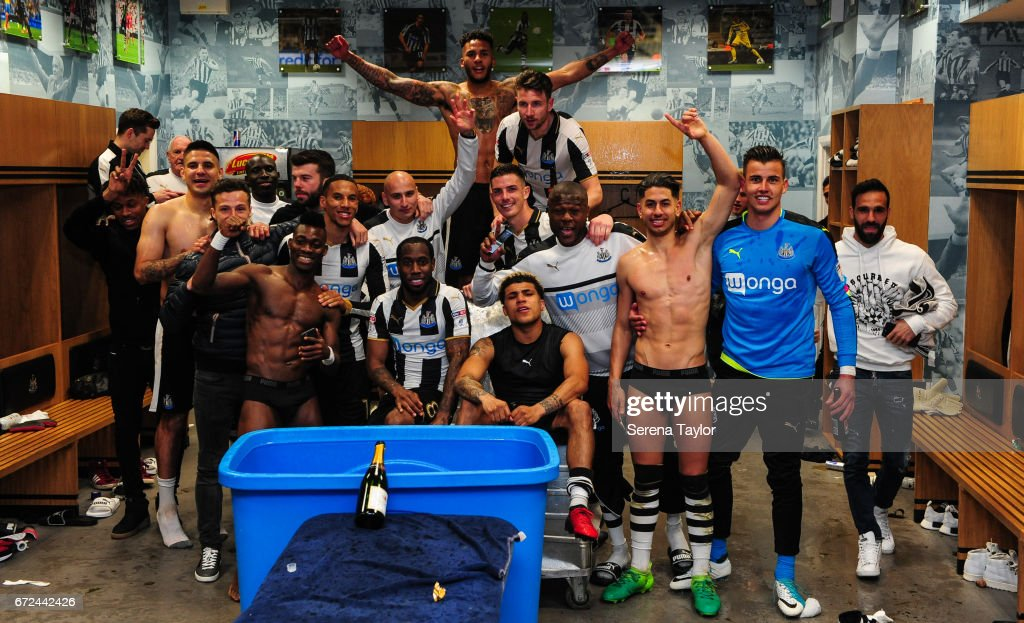 Newcastle players celebrate in the dressing room after sealing promotion to the premier league during the Sky Bet Championship match between Newcastle United and Preston North End at St.James' Park on April 24, 2017 in Newcastle upon Tyne, England.