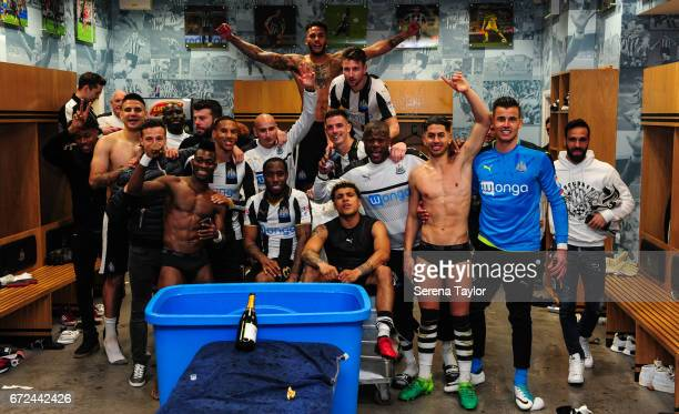 Newcastle players celebrate in the dressing room after sealing promotion to the premier league during the Sky Bet Championship match between...