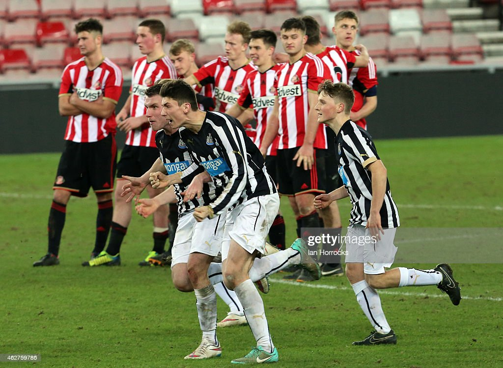Newcastle players celebrate in the foreground after they won a penalty shoot out during the FA Youth Cup match between Sunderland U18 and Newcastle United U18 at The Stadium of Light on February 04, 2015 in Sunderland, England.