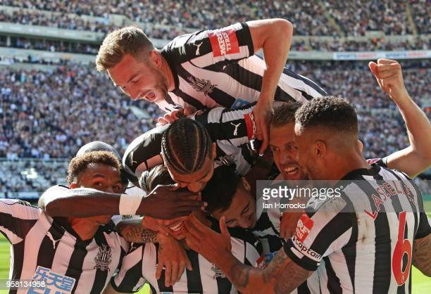 Newcastle players celebrate the third goal during the Premier League match between Newcastle United and Chelsea at St James Park on May 13 2018 in...