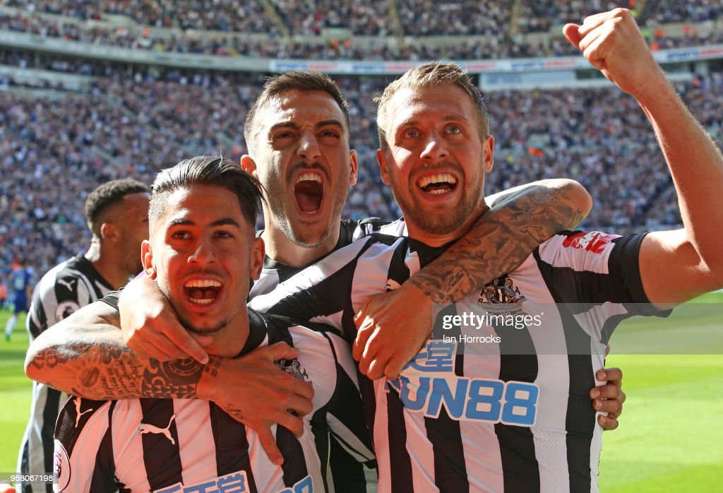 Newcastle players celebrate the third goal scored by Ayoze Perez (L) during the Premier League match between Newcastle United and Chelsea at St. James Park on May 13, 2018 in Newcastle upon Tyne, England.