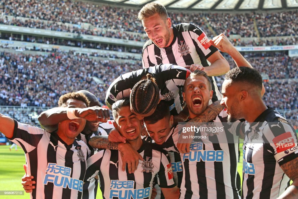 Newcastle players celebrate the third goal scored by Ayoze Perez during the Premier League match between Newcastle United and Chelsea at St. James Park on May 13, 2018 in Newcastle upon Tyne, England.