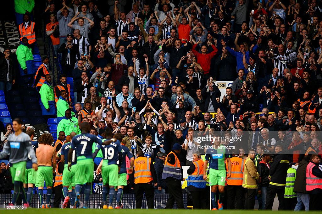 Newcastle players celebrate victory with their fans after the Barclays Premier League match between Tottenham Hotspur and Newcastle United at White Hart Lane on October 26, 2014 in London, England.
