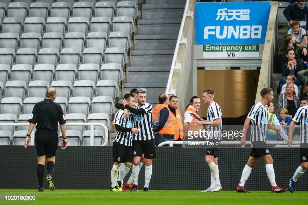 Newcastle players celebrate with Callum Roberts after he scores Newcastle's second goal during the Premier League 2 Match between Newcastle United...