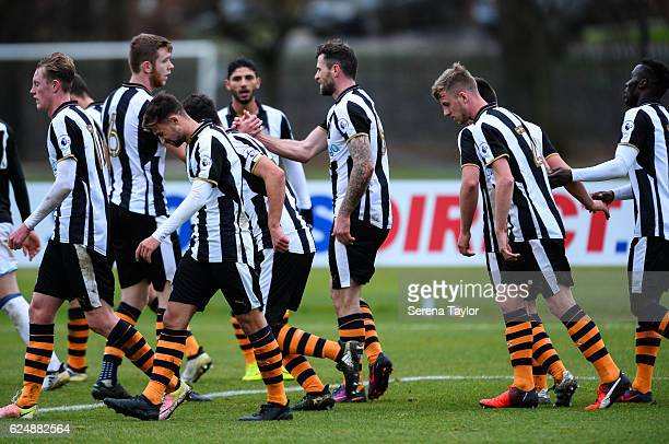 Newcastle players celebrate with Daryl Murphy after scoring the opening goal during the Premier League 2 Match between Newcastle United and West...