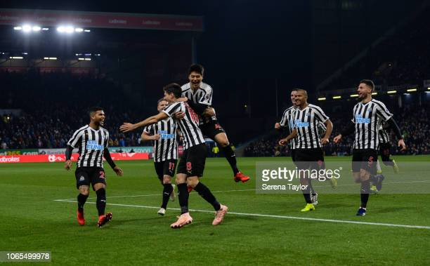 Newcastle players celebrate with Federico Fernandez after he scores the opening goal during the Premier League Match between Burnley FC and Newcastle...