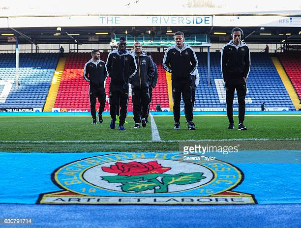 Newcastle players Daryl Murphy Christian Atsu DeAndre Yedlin Dwight Gayle and Isaac Hayden inspect the pitch at Ewood Park Home to Blackburn Rovers...