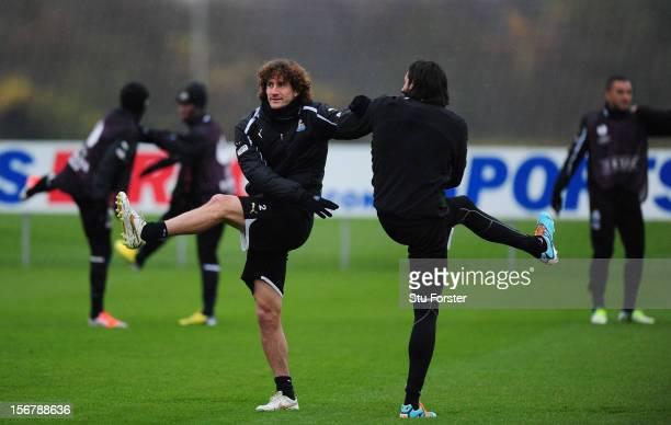 Newcastle players Fabricio Coloccini and Jonas Gutierrez warm up during Newcastle United training ahead of thursday's UEFA Europa League match...