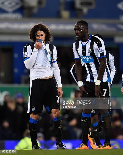 Newcastle players Fabricio Coloccini and Moussa Sissoko react after the first Everton penalty is given during the Barclays Premier League match...