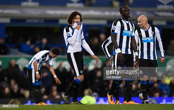 Newcastle players Fabricio Coloccini Moussa Sissoko and Jonjo Shelvey reacts after the first Everton penalty is given during the Barclays Premier...