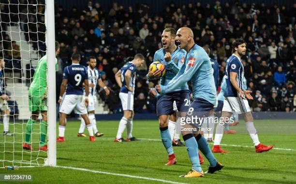 Newcastle players Florian Lejeune and Jonjo Shelvey Celebrate after Jonny Evans of West Bromwich Albion scores an own goal during the Premier League...