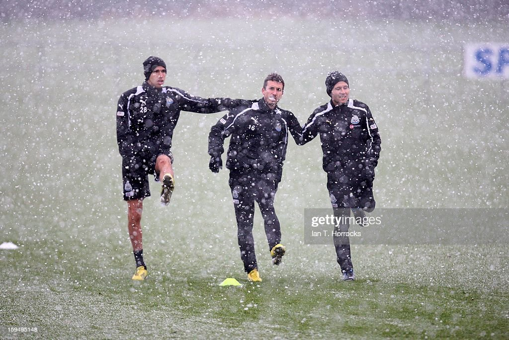 Newcastle players from the left Gabriel Obertan, Romain Amilfatano and Yohan Cabaye stretch during a snowy Newcastle United training session at the Little Benton Training Ground on January 14, 2013 in Newcastle upon Tyne, England.