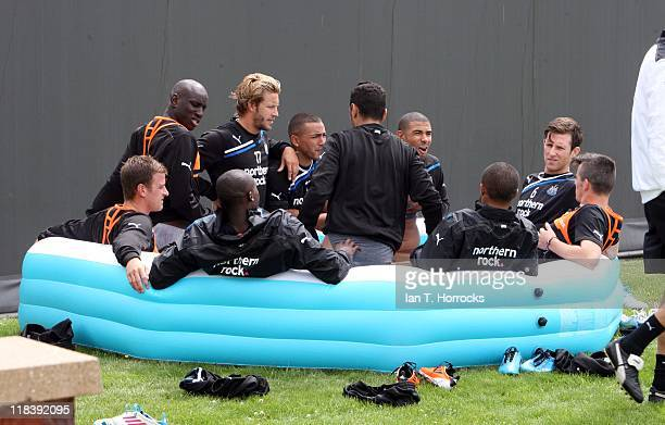 Newcastle players in Ice baths attend a Newcastle United training session at the Little Benton Training Ground on July 07 2011 in Newcastle upon Tyne...