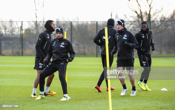 Newcastle players Isaac Hayden Jacob Murphy Massadio Haidara Ciaran Clark and Chancel Mbemba warm up during the Newcastle United training session at...