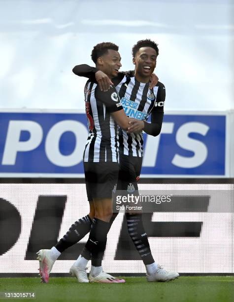 Newcastle players Jacob Murphy and Joe Willock celebrate after Willock had scored the winning goal during the Premier League match between Newcastle...