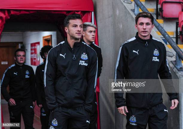 Newcastle players Jamie Sterry of Newcastle United Newcastle United Goalkeeper Nathan Harker and Owen Gallacher of Newcastle United walk out of the...