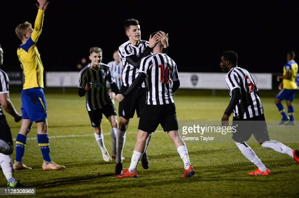 Newcastle Players Kelland Watts Celebrates with Luke Charman after he scored the opening goal during the Premier League 2 Match between Newcastle...