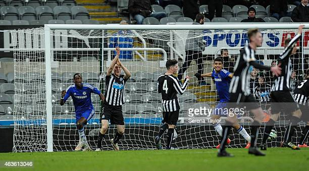Newcastle Players Kyle Cameron Ben Drennan and Callum Williams protest for handball after Tammy Abraham of Chelsea scores a goal using his arm during...