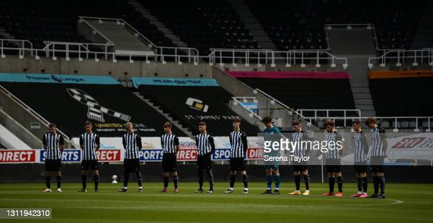 Newcastle players line up for a minutes silence during the fifth round of the FA Youth Cup between Newcastle United and Watford FC at St James' Park...
