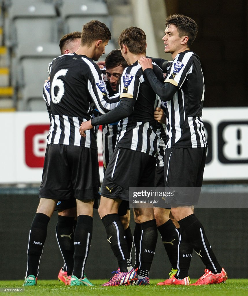 Newcastle players (Seen L-R) Lubomir Satka, Adam Laidler (partially hidden) Liam Smith and Alex Gilliead celebrate with Callum Roberts (C) after he scores Newcastle's third goal during the Under 21 Premier League match between Newcastle United and Blackburn Rovers at St. James' Park on May 5, 2015, in Newcastle upon Tyne, England, United Kingdom.
