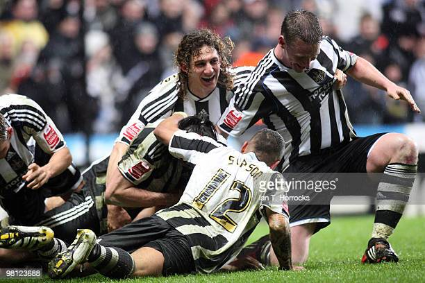 Newcastle players mob Jose Enrique of Newcastle United after he scored the second goal during the Coca Cola Championship match between Newcastle...