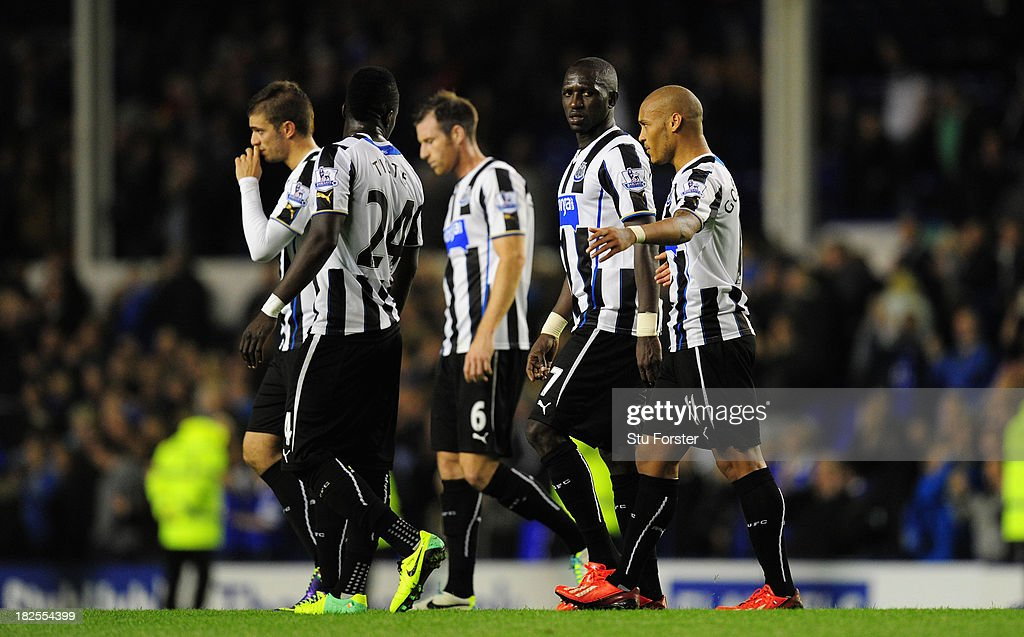 Newcastle players Moussa Sissoko (2nd right) and Yoan Gouffran (r) discuss the game after the Barclays Premier League match between Everton and Newcastle United at Goodison Park on September 30, 2013 in Liverpool, England.