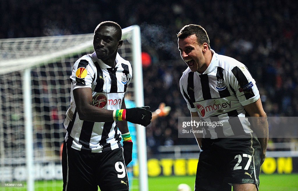 Newcastle players Papiss Cisse (l) and Steven Taylor celebrate the winning goal during the UEFA Europa League Round of 16 second leg match between Newcastle United FC and FC Anji Makhachkala at St James' Park on March 14, 2013 in Newcastle upon Tyne, England.
