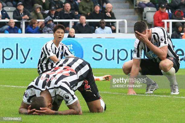 Newcastle players react after Newcastle United's US defender DeAndre Yedlin scored an own goal for Chelsea's second during the English Premier League...