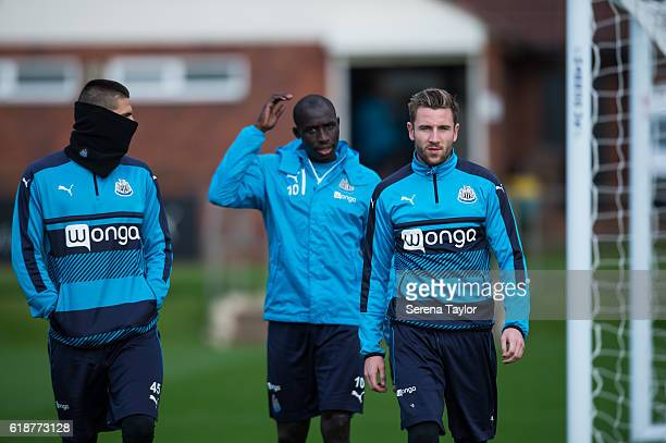 Newcastle Players seen LR Aleksandar Mitrovic Mohamed Diame and Paul Dummett walk outside during Newcastle United Training Session at The Newcastle...