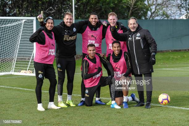 Newcastle players seen LR Ayoze Perez Rob Elliot Jamaal Lascelles Jacob Murphy Sean Longstaff Isaac Hayden pose for a photo with Newcastle United...