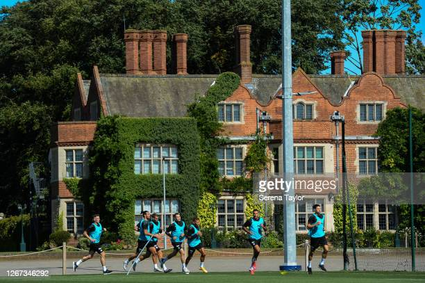 Newcastle players seen LR Ciaran Clark Andy Carroll Florian Lejuene Javier Manquillo Dwight Gayle Jamaal Lascelles and Federico Fernández run in an...