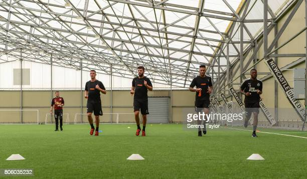 Newcastle players seen LR Ciaran Clark Grant Hanley Jamaal Lascelles and Chancel Mbemba jog during the Newcastle United Training Session at the...