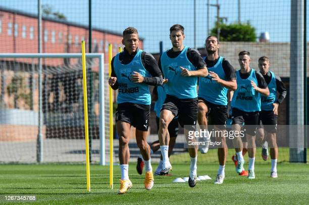 Newcastle players seen LR Dwight Gayle Federico Fernández Andy Carroll Ciaran Clark and Florian Lejuene warm up during the Newcastle United Training...