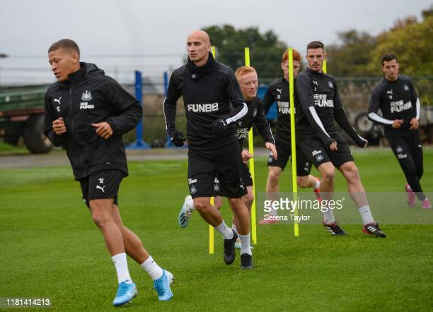 Newcastle players seen LR Dwight Gayle Jonjo Shelvey Matthew Longstaff Ciaran Clark Jack Colback and Javier Manquillo warm up during the Newcastle...