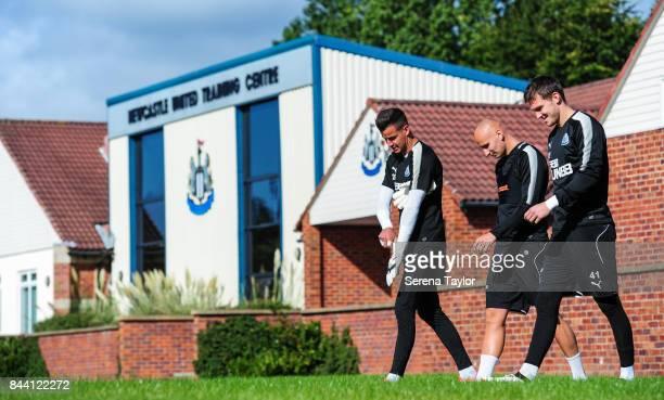Newcastle players seen LR Goalkeeper Karl Darlow Jonjo Shelvey and Goalkeeper Freddie Woodman walk outside during the Newcastle United Training...