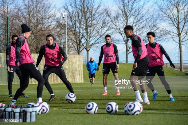 Newcastle players seen L-R Isaac Hayden, Sean Longstaff, Andy Carroll, Joelinton, Joe Willock and Jamal Lewis play a game of boxes during the...