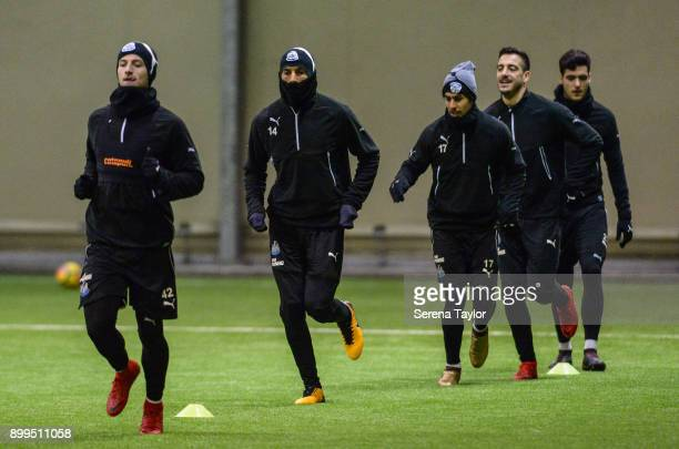 Newcastle players seen LR Jamie Sterry Isaac Hayden Ayoze Perez Joselu and Mikel Merino warm up during the Newcastle United Training session at the...