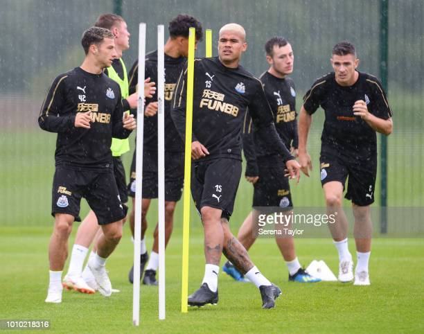 Newcastle players seen LR Jamie Sterry Sean Longstaff Josef Yarney Kenedy Callum Roberts and Ciaran Clark warm up during the Newcastle United...