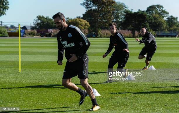 Newcastle players seen LR Jesus Gamez Jamie Sterry and Jonjo Shelvey all race around cones during the warm up session of the Newcastle United...