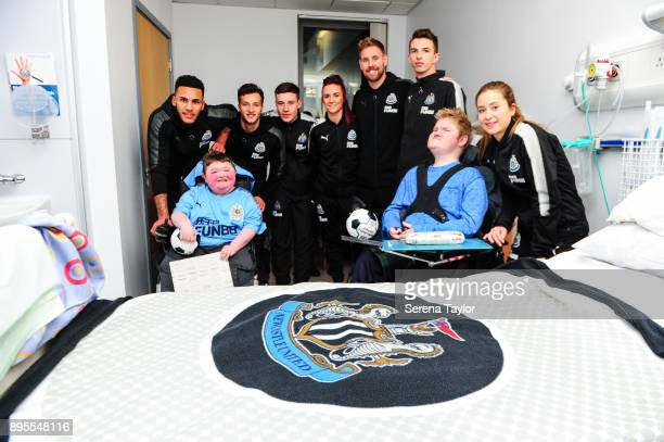 Newcastle Players seen LR JJamaal Lascelles Jamie Sterry Callum Roberts Brooke Cochrane Rob Elliot Dan Barlaser and Emily Tate pose for a photo with...