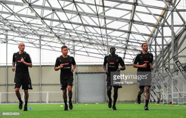 Newcastle players seen LR Jonjo Shelvey Dwight Gayle Mohamed Diame and Isaac Hayden jog during the Newcastle United Training Session at the Newcastle...