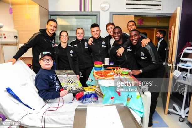 Newcastle Players seen LR Joselu Siobhan Jones Ellie Mark Dan Ward Liam Smith Henri Saivet Isaac Hayden and Massadio Haidara pose for a photo with a...